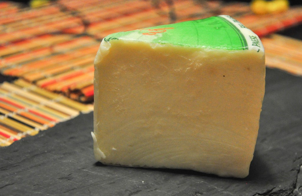A Piece of Bel Paese Cheese on the table
