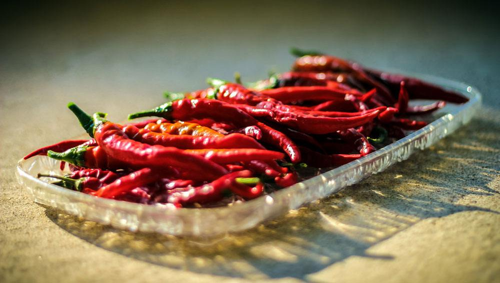 Cayenne Peppers on the glass tray