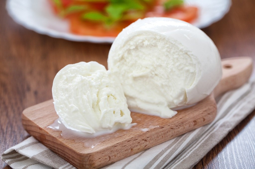 fresh mozzarella on the chopping board