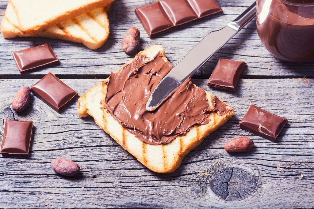 bread with melt nutella and a knife