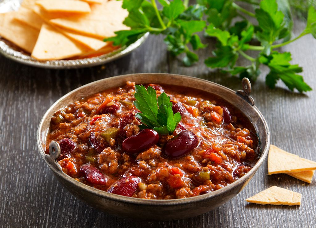 A bowl of chili con carne on the table