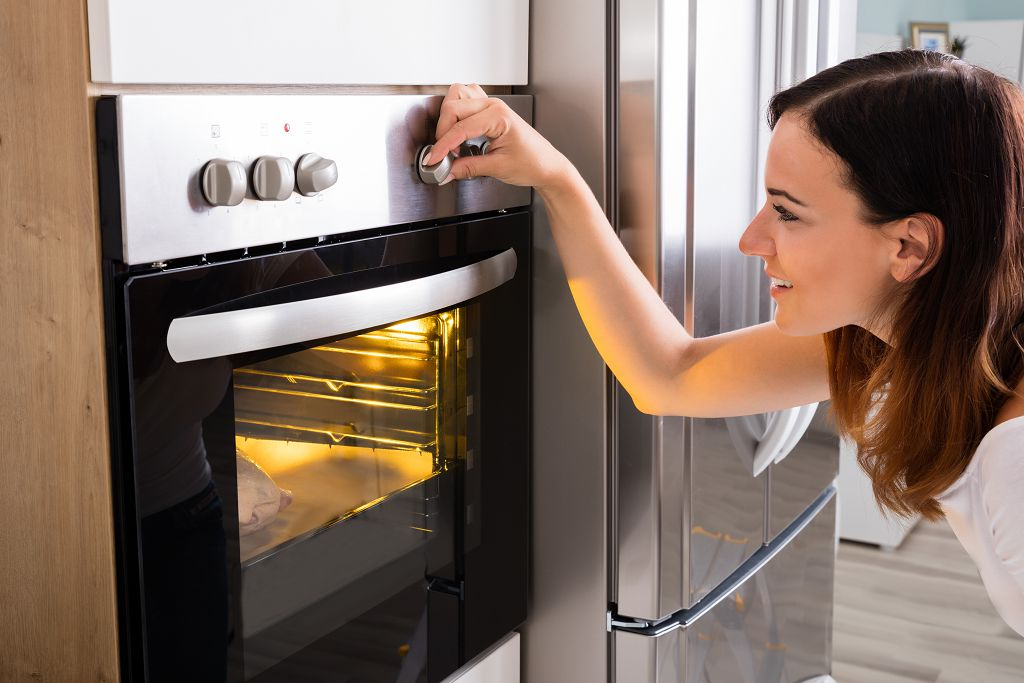 the woman uses the oven