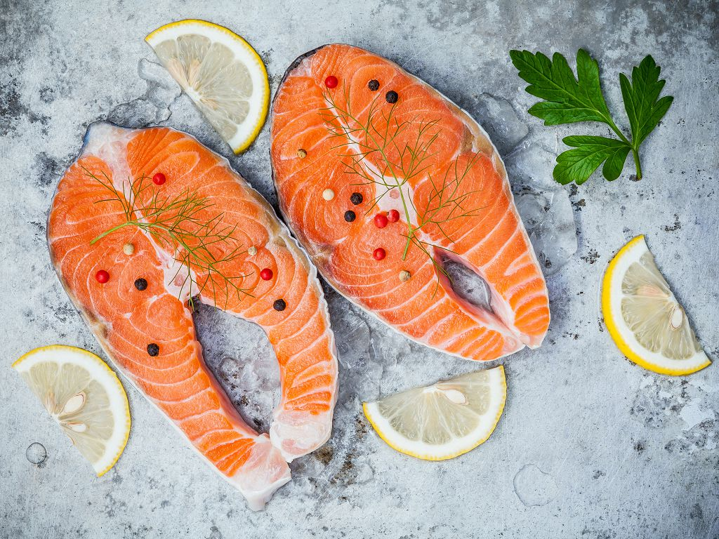 pieces of fresh salmon and sliced lemon