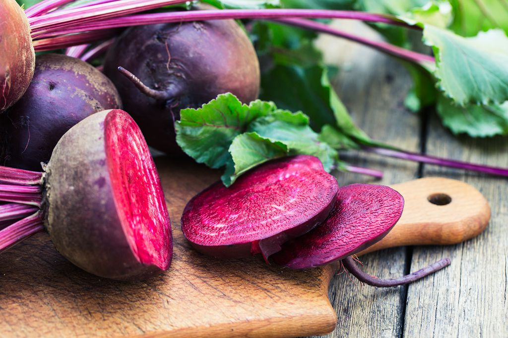Beets and slices of Beets on the chopping board