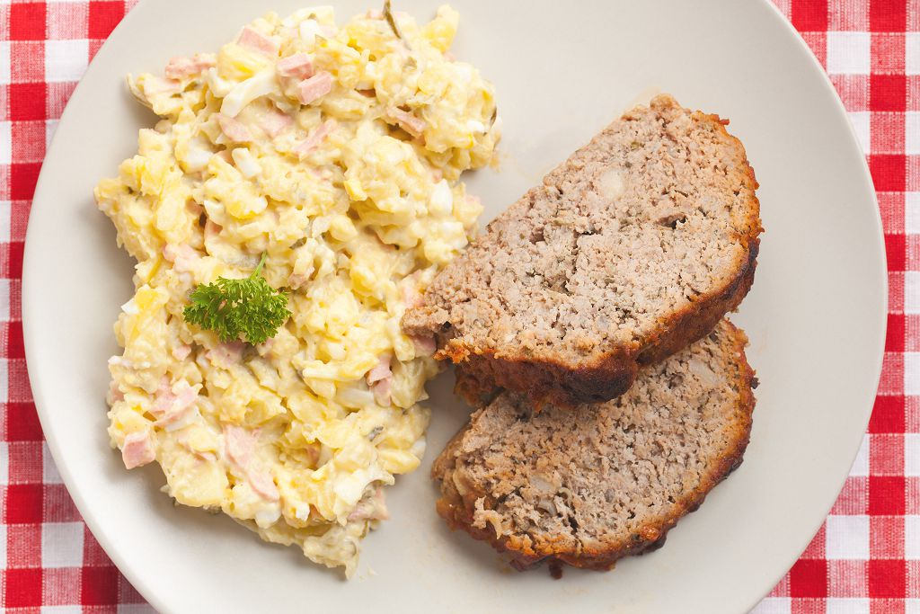 Potato Salad and slices of black bread on the plate