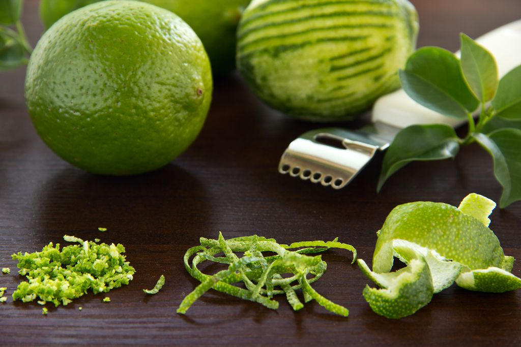 Kaffir lime leaves, lime peel, a lime and fruit scraper