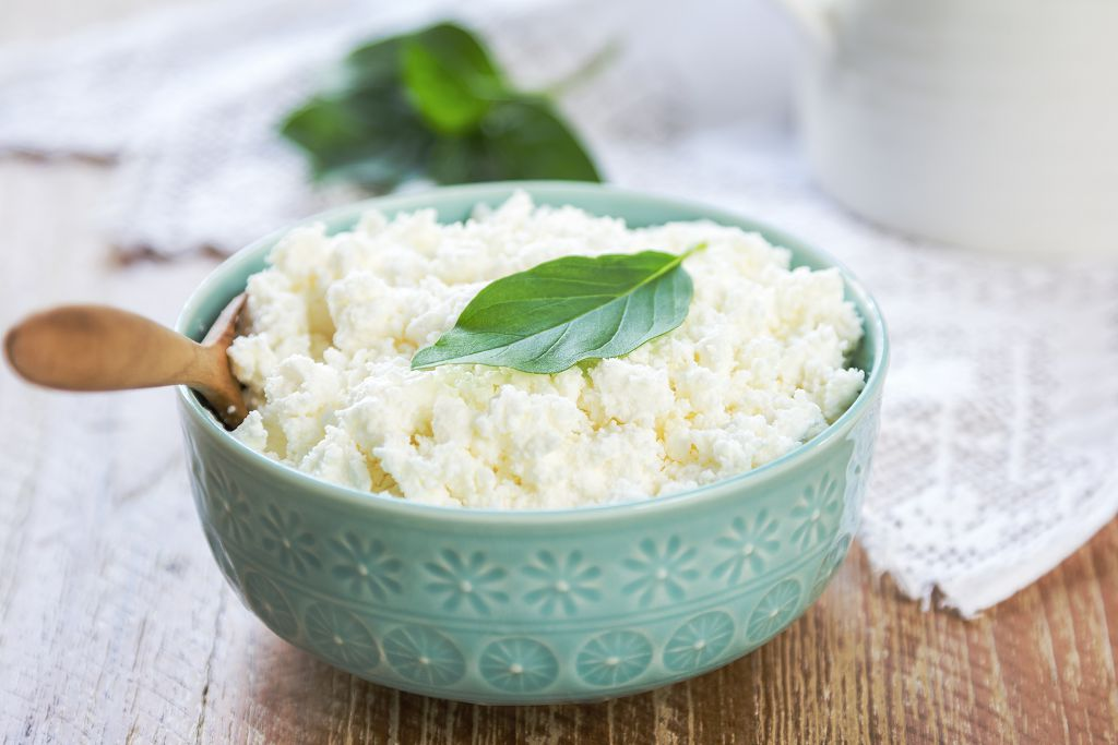 A bowl of Ricotta Cheese and a spoon