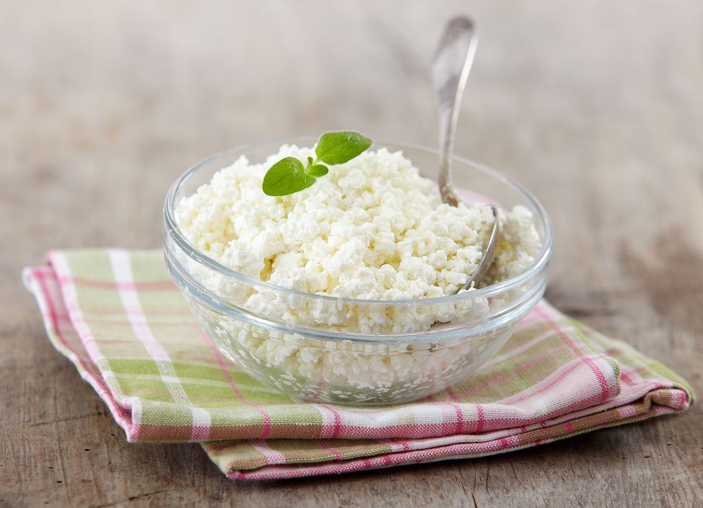 A bowl of Cottage Cheese and a spoon