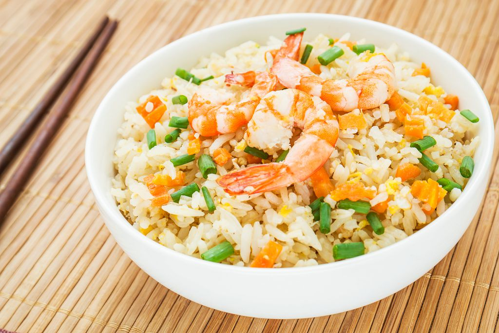 Divide the brown rice and shrimp mixture among four serving bowls.