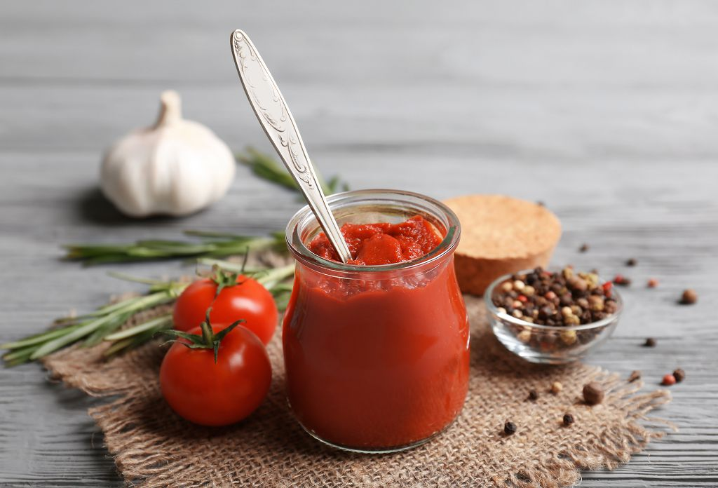 A jar of Mixing Tomato Paste and tomatoes