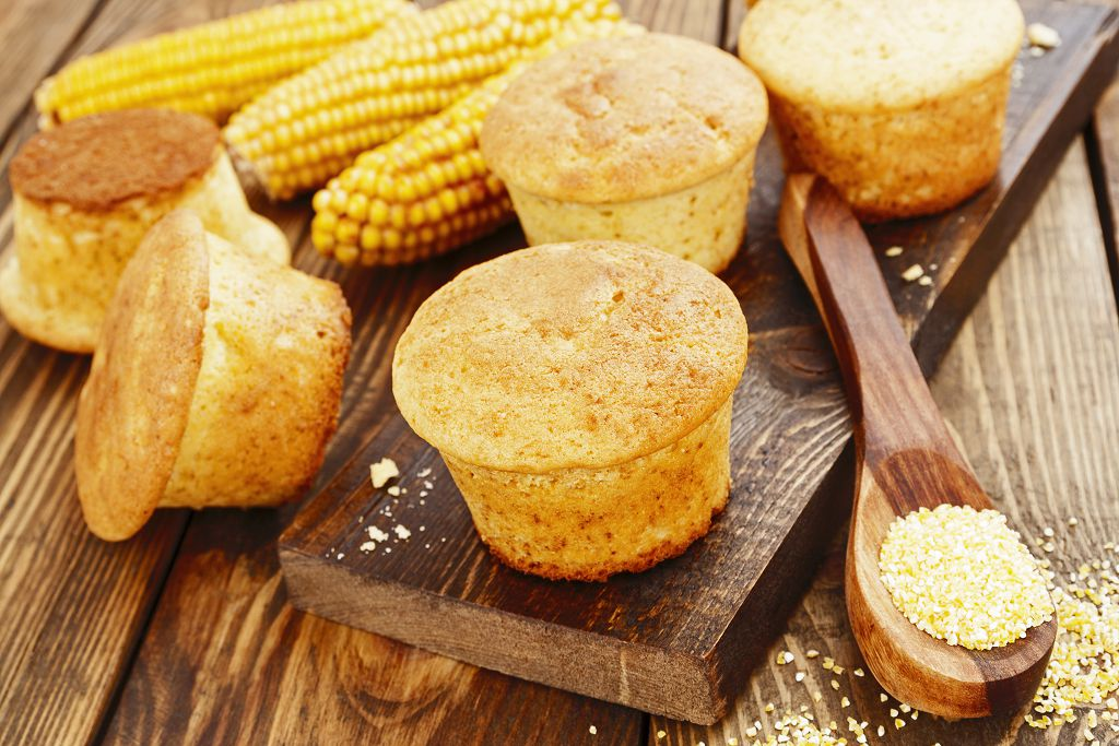 corn, corn flour, cake and a spoon on the table