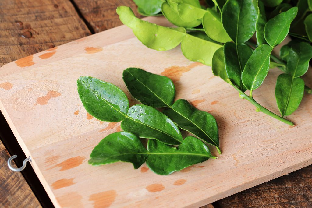 Kaffir Lime Leaves on the chopping board