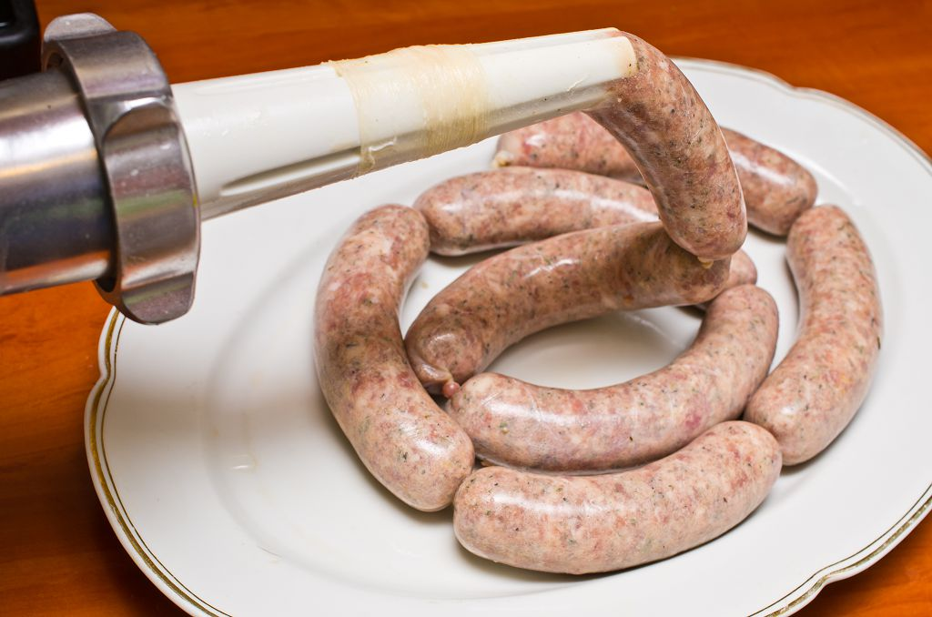 A Sausage Stuffer and Sausage on the plate