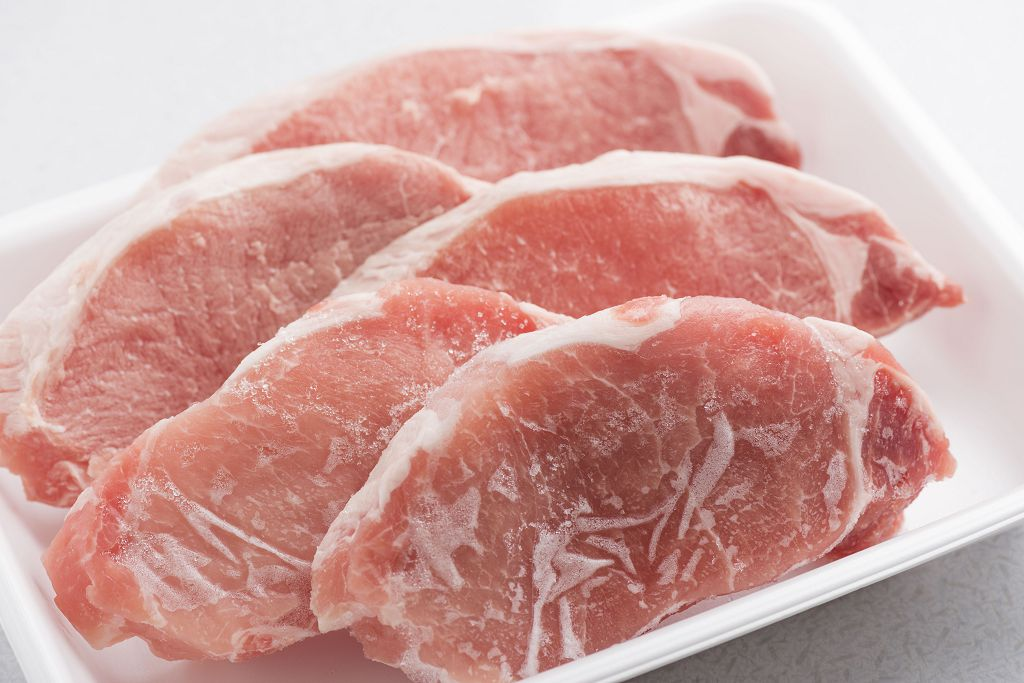 Slices of frozen meat on the plate