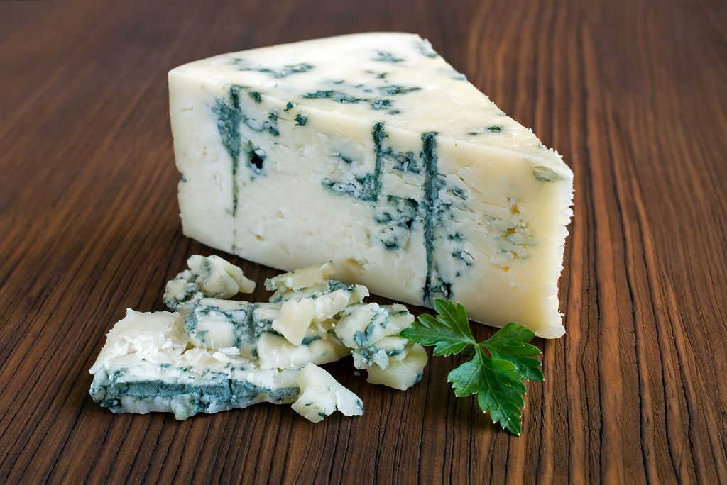 Slices of Blue Cheese on the table