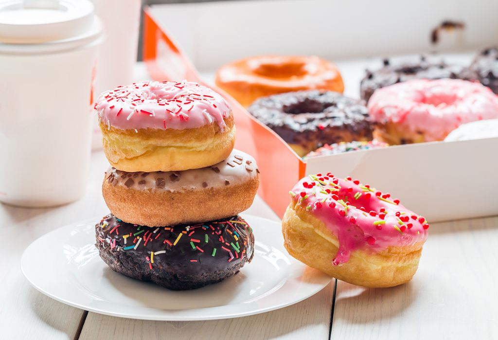 Colorful Donuts in the box and plate of donuts