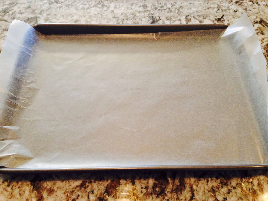 Line the bottom of the cookie sheet with wax paper