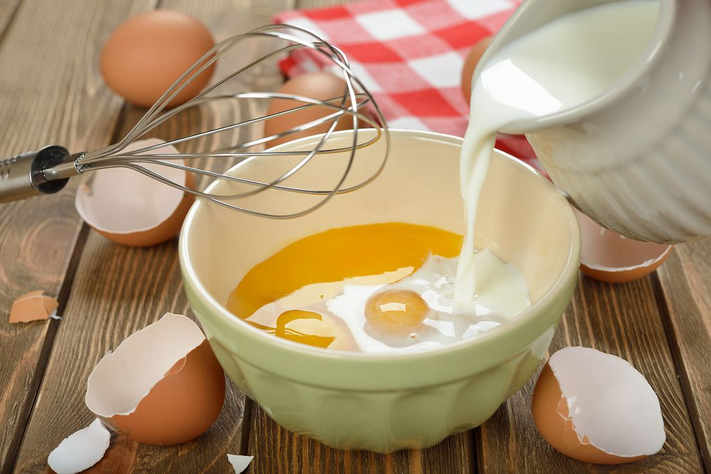 Whisk together the eggs, half-and-half, vanilla extract, honey, salt and cinnamon in a bowl