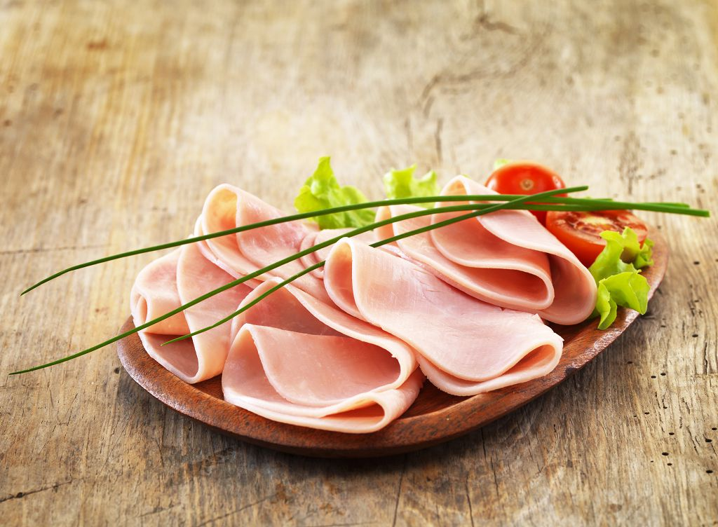 Slices of ham and vegetables on the plate