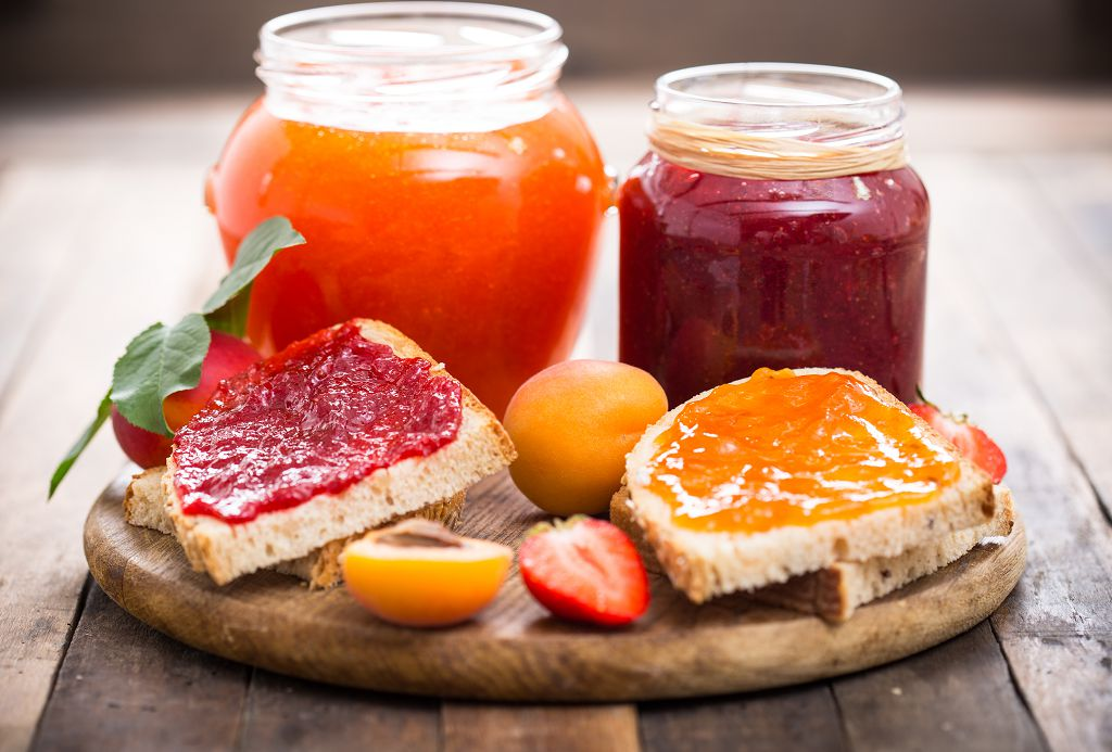 bottles of Freeze Jam, fruits and breads on the chopping board