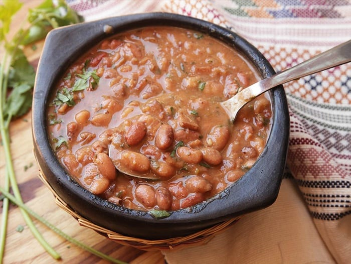 A bowl of Mexican Pinto beans and a spoon