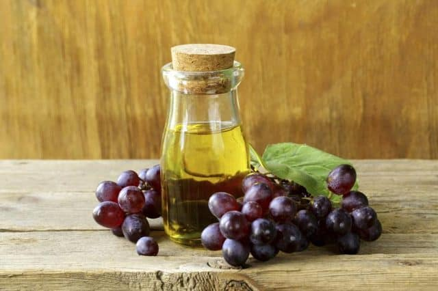 grape seed oil and grape on the table