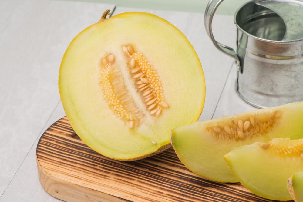 slices of honeydew melons on the chopping board