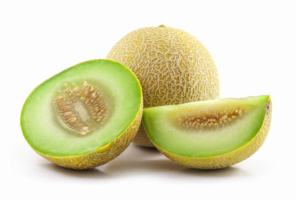 honeydew melons and slices of honeydew melons