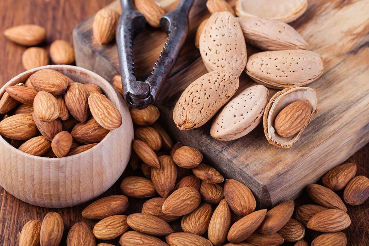 almonds on the chopping board and a bowl of  almonds