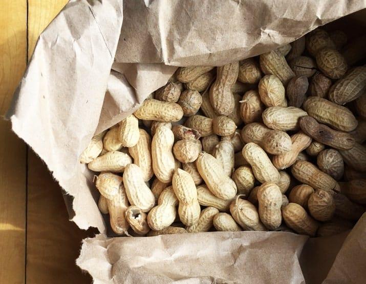 a paper bag of Raw Peanuts