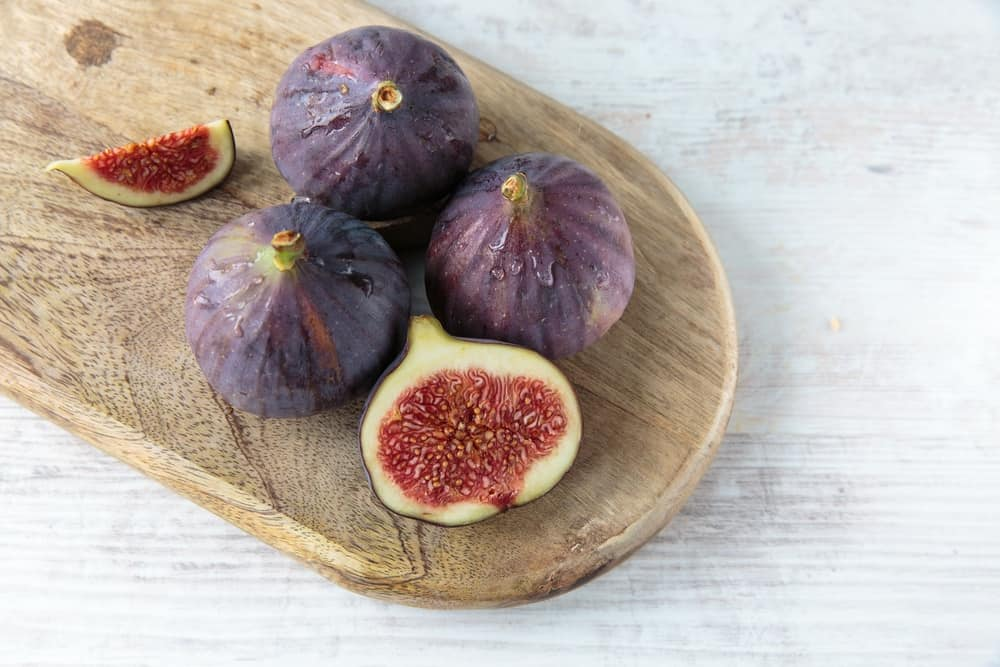 Slices of Fig and Fig on the chopping board